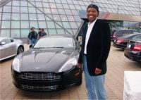 "Jack at the Rock Hall Museum on April 14th with ""the CAR"" ( 2012 Aston Martin) that K.C. Jones often promises to give away on Jazz Sunday"